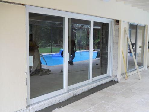 PGT Series 770 XXO Sliding Glass Door Installation In Progress. New Door  Has Been Inset Into Structural Tie Beam Area.